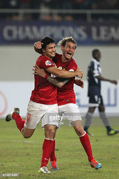 Elkeson of Guangzhou Evergrande celebrates with his teammate Alessandro Diamanti after scoring his team's third goal during the Asian Champions...
