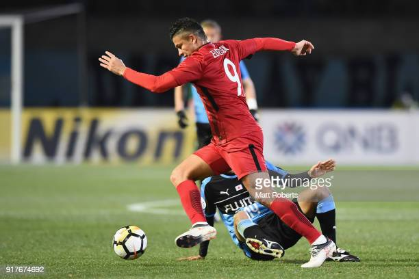 Elkeson of Shanghai SIPG and Yoshito Okubo of Kawasaki Frontale compete for the ball during the AFC Champions League Group F match between Kawasaki...