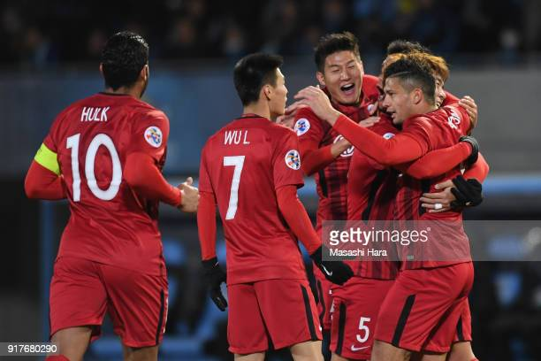 Elkeson of Shanghai SIPG celebrates scoring the opening goal with his team mates during the AFC Champions League Group F match between Kawasaki...