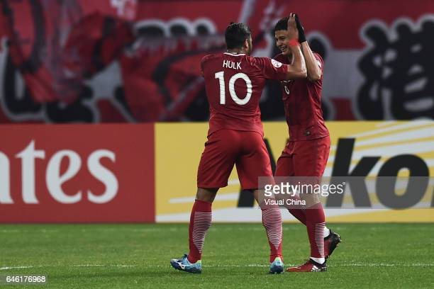 Elkeson of Shanghai SIPG celebrates with Hulk after scoring his team's fourth goal during the AFC Champions League 2017 Group F match between...