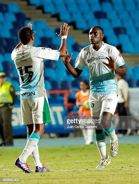 Elkin Mosquera of Jaguares celebrates with teammates after scoring his team's first goal during a match between America de Cali and Jaguares as part...