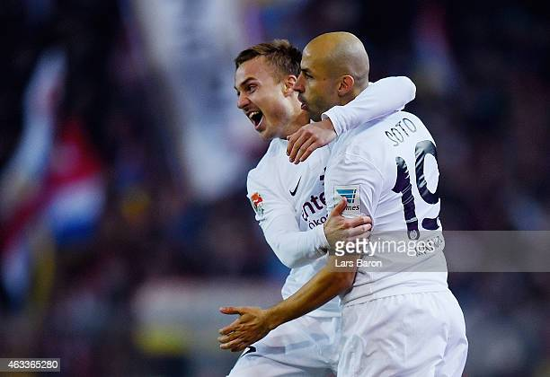 Elkin Soto of 1 FSV Mainz 05 celebrates with team mate Pierre Thomas Robin Bengtsson as he scores the opening goal during the Bundesliga match...