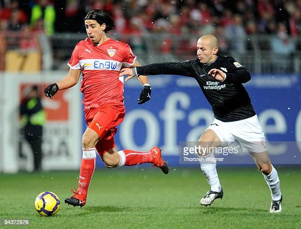 Elkin Soto of Mainz battles for the ball with Sami Khedira of Stuttgart during the Bundesliga match between FSV Mainz 05 and VFB Stuttgart at...