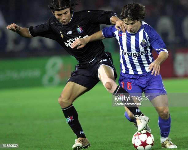 Elkin Soto of Once Caldas tackes Diego Ribas da Cunha of FC Porto during the Toyota Cup between FC Porto and Once Caldas at Yokohama International...