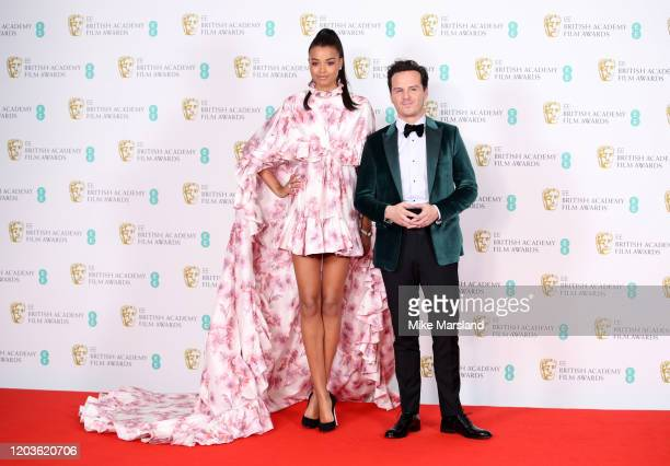 Ella Balinska and Andrew Scott pose in the Winners Room during the EE British Academy Film Awards 2020 at Royal Albert Hall on February 02, 2020 in...