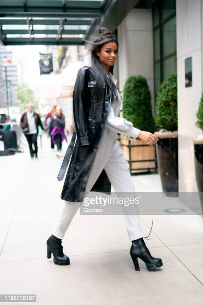 Ella Balinska is seen wearing Sorelle Moscow top and pants with Prada jacket and boots in Midtown on November 05 2019 in New York City