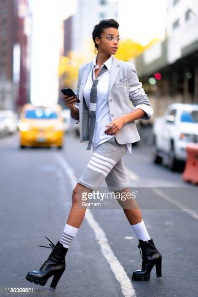 Ella Balinska is seen wearing Thom Browne in Midtown on November 08, 2019 in New York City.