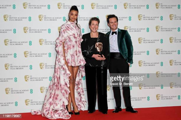 "Ella Balinska, Jacqueline Durran, winner of Best Costume Design for ""Little Women"", and Andrew Scott pose in the Winners Room at the EE British..."