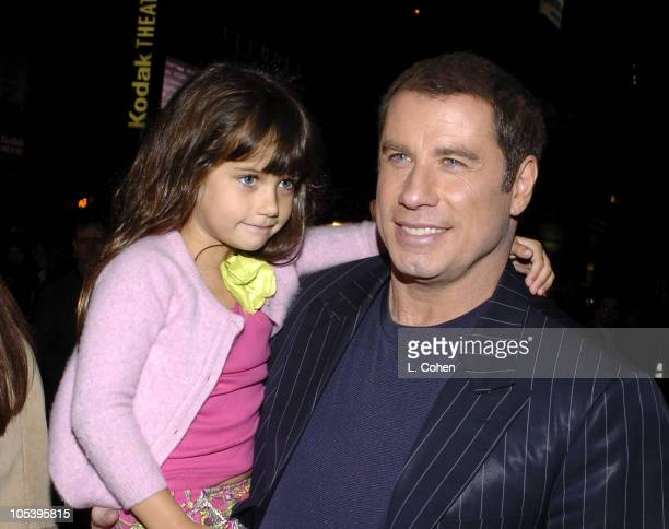 Ella Bleu Travolta and John Travolta during 'Be Cool' Los Angeles Premiere Red Carpet at Grauman's Chinese Theater in Los Angeles California United...
