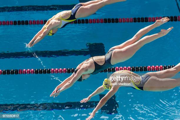 Ella Eastin of the Stanford Cardinal dives at the start of the 200 Intermediate Medley event of an NCAA PAC12 Women's swim meet against the...