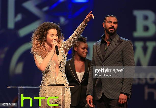 Ella Eyre with Nicola Adams and David Haye who presented her with an award onstage at the MOBO Awards at SSE Arena on October 22 2014 in London...