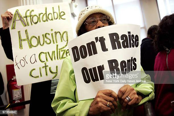 Ella Gordon of Flushing, Queens, holds a sign as she listens in on a meeting of the Rent Guidelines Board at their headquarters on Reade St. Tenants...