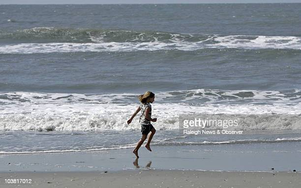 Ella Hamilton frolics in the surf on Atlantic Beach North Carolina Friday September 3 2010 People on the Crystal Coast were relieved by the near miss...