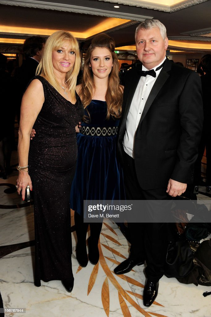 Ella Henderson (C) and parents Michelle and Sean attend a drinks reception at the Amy Winehouse Foundation Ball held at The Dorchester on November 20, 2012 in London, England.