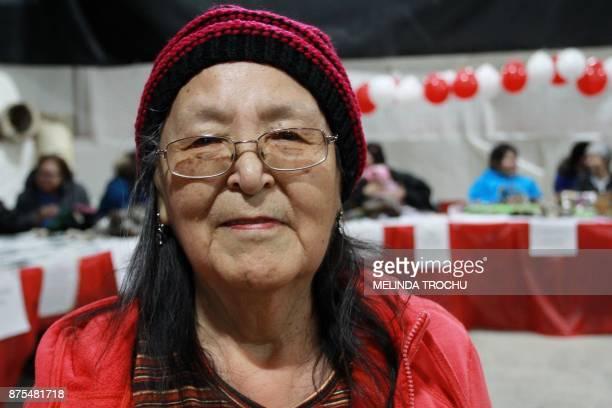 Ella Jean Nogasak a 72 yearold resident of Tuktoyaktuk poses as he sells traditional crafts during the celebration at the Donald Kuptana Sr Arena...