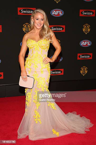 Ella Keddie the partner of Jobe Watson of the Bombers poses ahead of the 2013 Brownlow Medal at Crown Palladium on September 23 2013 in Melbourne...