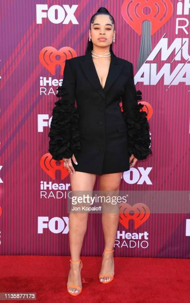 Ella Mai arrives at the 2019 iHeartRadio Music Awards which broadcasted live on FOX at Microsoft Theater on March 14 2019 in Los Angeles California