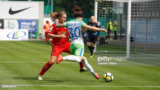 Ella Masar of Wolfsburg challenges AnnKathrin Vinken of Koeln during the Allianz Frauen Bundesliga match between VfL Wolfsburg and 1 FC Koeln at...