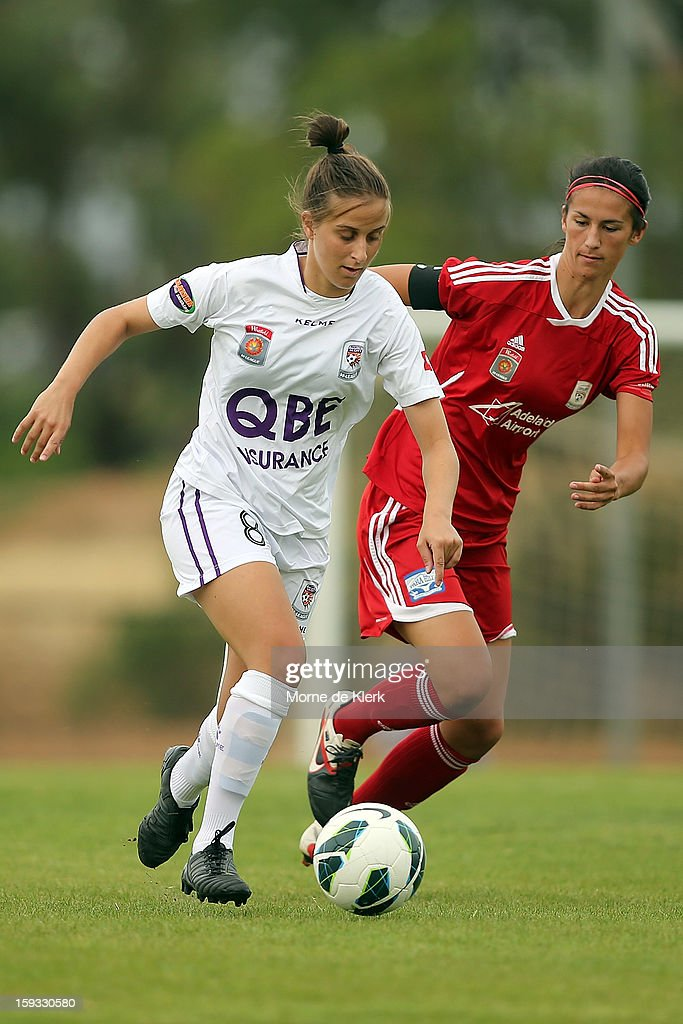 Ella Mastantonio of Perth gets away from Abby Erceg of Adelaide during the round 12 W-League match between Adelaide United and the Perth Glory at Burton Park on January 12, 2013 in Adelaide, Australia.