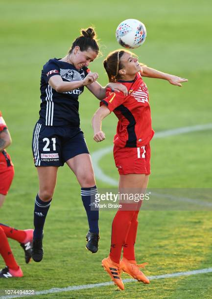 Ella Mastrantonio of Melbourne Victory competes with Veronica Latsko of Adelaide United during the round eight WLeague match between Adelaide United...