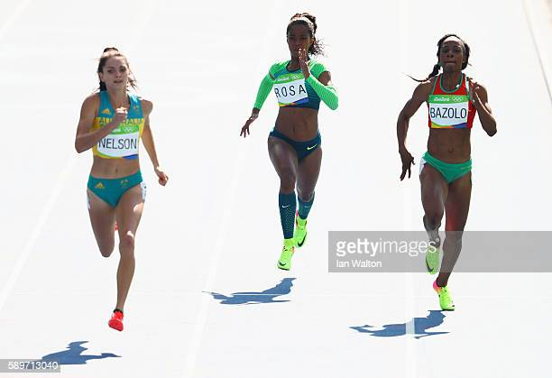 Ella Nelson of Australia Vitoria Cristina Rosa of Brazil and Lorene Dorcas Bazolo of Portugal compete in round one of the Women's 200m on Day 10 of...