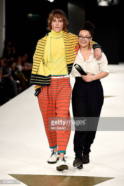Ella Nisbett accepts an award at the Graduate Fashion Week George Gold Award show at The Old Truman Brewery on June 2 2015 in London England