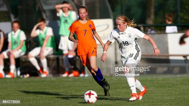 Ella Peddemors of the Netherlands challenges Livinia Seifert of Germany during the U15 girl's international friendly match between Germany and...
