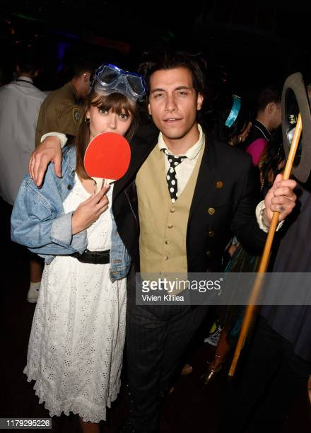 Ella Purnell and Rob Raco attend Podwall Entertainment's 10th Annual Halloween Party presented by Maker's Mark on October 31 2019 in West Hollywood...