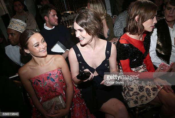 Ella Purnell Sai Bennett and Alexa Chung attend the Dior Cruise Collection show 2017 at Blenheim Palace on May 31 2016 in Woodstock England