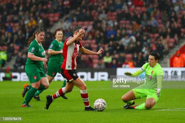 Ella Pusey of Southampton rounds Sue Wood of Coventry United during the Women's FA Cup fourth round match between Southampton FC Women and Coventry...