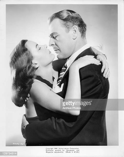 Ella Raines and Brian Donlevy hold each other in a scene from the film 'Impact' 1949