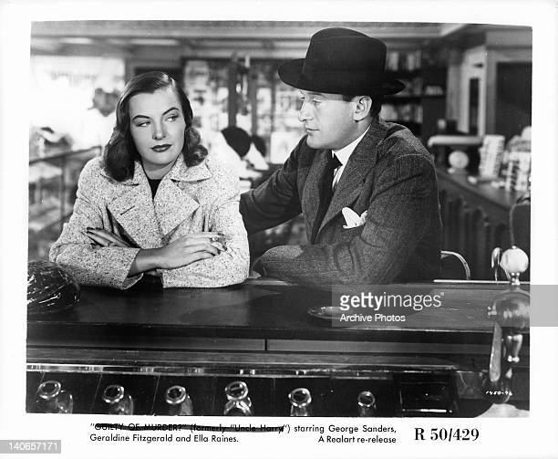 Ella Raines and George Sanders sit at bar in a scene from the film 'The Strange Affair Of Uncle Harry' 1945