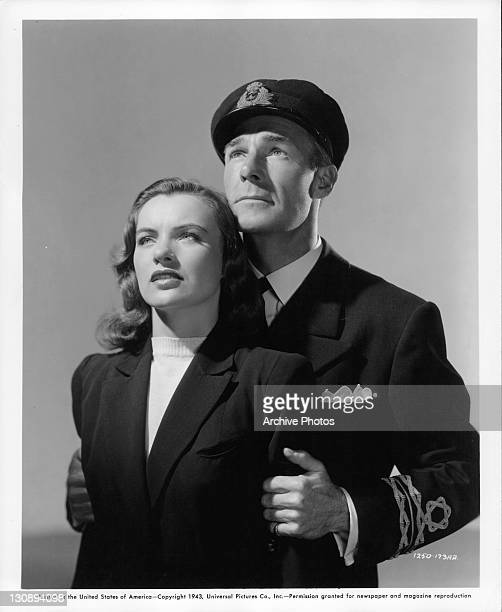 Ella Raines is held by Randolph Scott in a scene from the film 'Corvette K225' 1943