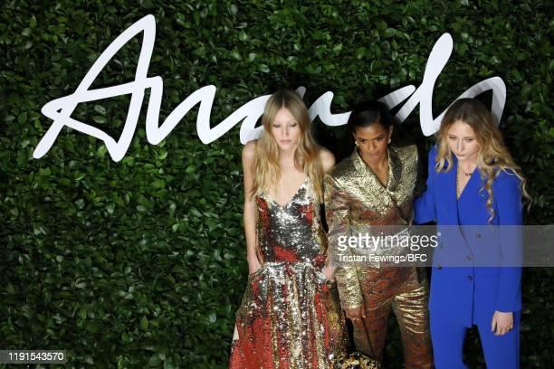 Ella Richards Ramla Ali and Elfie Reigate arrive at The Fashion Awards 2019 held at Royal Albert Hall on December 02 2019 in London England