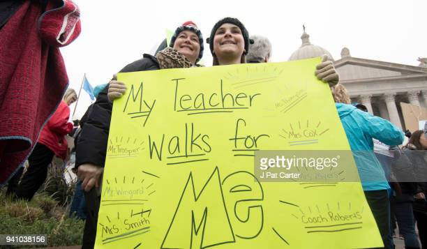 Ella Roach holds a protest sign in support of her teacher Kimberly Cox during a rally at the state capitol on April 2 2018 in Oklahoma City Oklahoma...