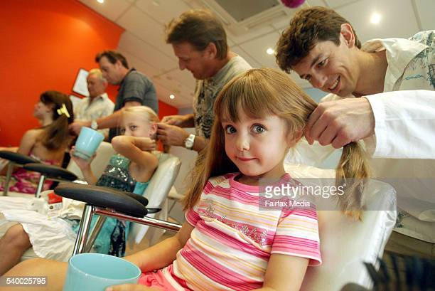 Ella Ryan right with her father John and Tamesha Hawkeswood and her father Michael at the Dad and Daughter Hair workshop at Avalon 18 March 2006 SHD...