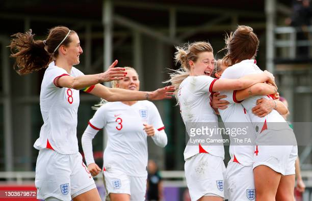 Ella Toone of England celebrates with teammates Rachel Daly, Ellen White and Jill Scott after scoring their team's sixth goal during the Women's...