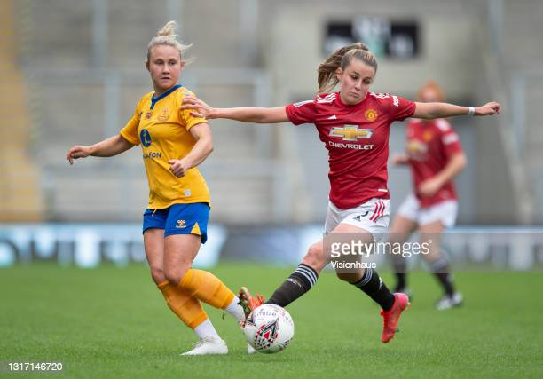 Ella Toone of Manchester United and Izzy Christiansen of Everton in action during the Barclays FA Women's Super League match between Manchester...