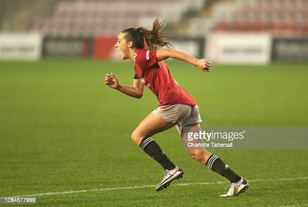 Ella Toone of Manchester United celebrates after scoring her team's first goal during the Barclays FA Women's Super League match between Manchester...