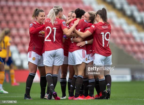 Ella Toone of Manchester United celebrates scoring their team's first goal with team mates Christen Press, Jackie Groenen, Millie Turner, Jane Ross,...