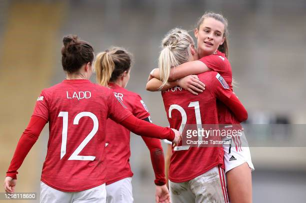Ella Toone of Manchester United celebrates with team mate Millie Turner after scoring their side's second goal during the Barclays FA Women's Super...