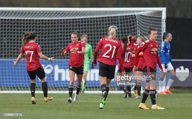 Ella Toone of Manchester United celebrates with team mate Ona Battle after scoring their side's first goal during the Barclays FA Women's Super...