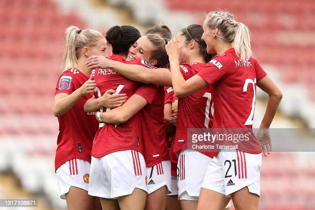 Ella Toone of Manchester United celebrates with team mates Jackie Groenen, Christen Press, Jane Ross and Millie Turner after scoring her team's first...