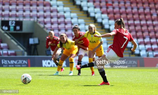 Ella Toone of Manchester United scores a penalty for her team during the Barclays FA Women's Super League match between Manchester United Women and...