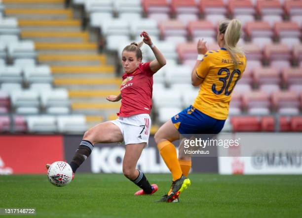 Ella Toone of Manchester United shoots past Poppy Pattinson of Everton to score their team's first goal during the Barclays FA Women's Super League...
