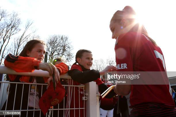 Ella Toone of Manchester United Women signs autographs for fans following victory in the WSL 2 match between Tottenham Hotspur Women and Manchester...