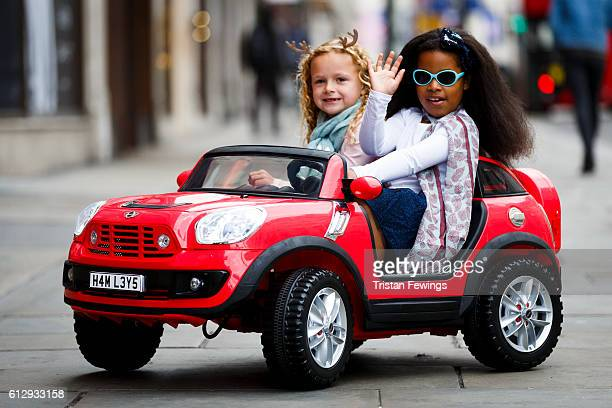 Ella Twigg and Queenie Chappell drive a BMW Mini Beechcomber as Hamley's announce it's top ten toys for Christmas at Hamleys on October 6 2016 in...