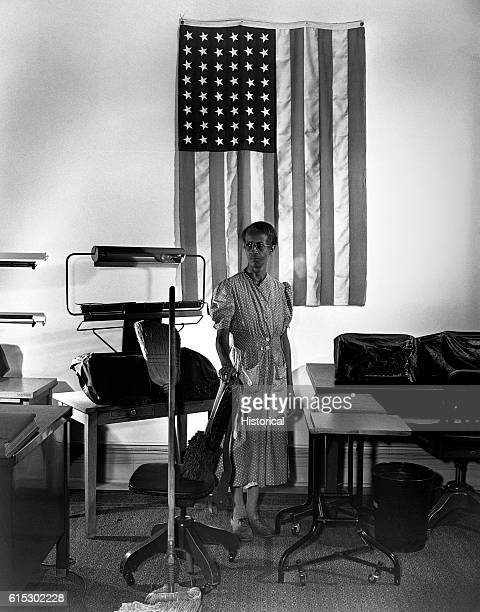 Ella Watson a US government charwoman who provides for a family of six on a salary of $1080 per year Washington DC August 1942