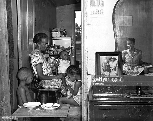 Ella Watson a US government charwoman with her adopted daughter and three grandchildren Washington DC August 1942