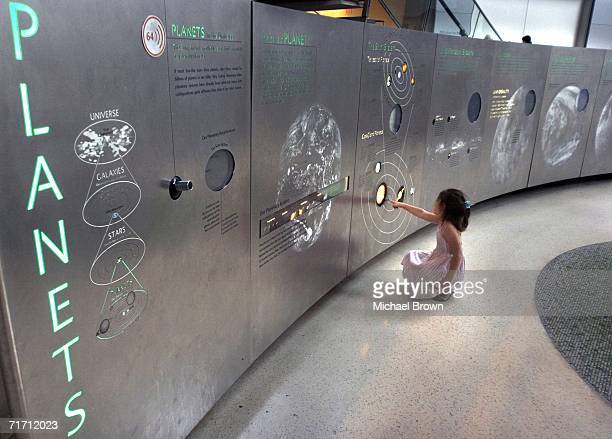 Ella Wolfman from Israel walks around the American Museum of Natural Historys Cullman Hall of the Universe August 24 2006 in New York City After a...
